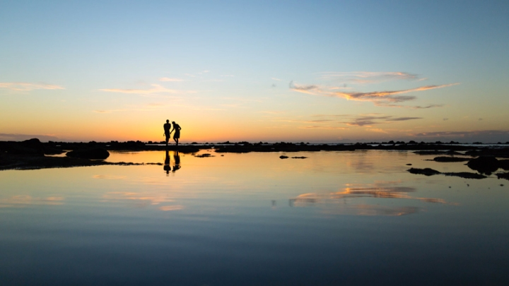 Two people at sunset by Sebastien Gabriel